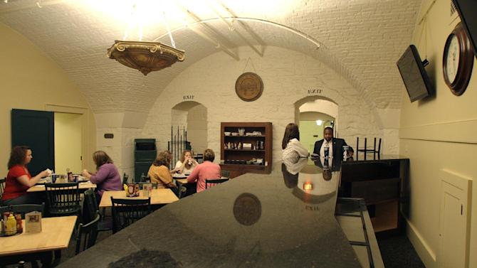 Patrons eat lunch in the dining room of the Statehouse cafe where a new counter top was installed Monday, Aug. 1, 2011, in Columbus, Ohio.  State officials are debating a proposal to establish what would apparently be the nation's first statehouse bar.  (AP Photo/Jay LaPrete)