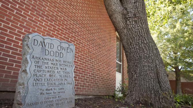 In this photo taken Sept. 18, 2012, a monument to teenage Confederate spy David O. Dodd, who was executed in 1864, is displayed in front of an elementary school named for him in Little Rock, Ark. Dodd is seen as a folk hero by many in his hope state. (AP Photo/Danny Johnston)