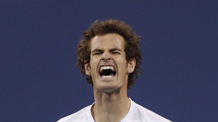 Britain's Murray reacts after missing a point against Serbia's Djokovic during the men's singles final match at the U.S. Open tennis tournament in New York