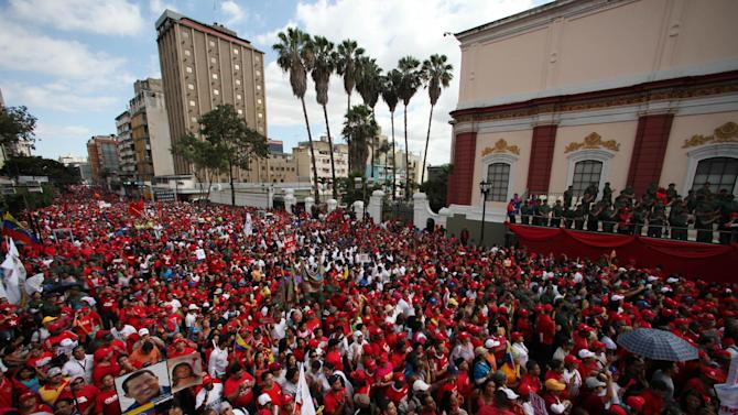 Supporters of Venezuela's president Hugo Chavez gather for a symbolic inauguration for Chavez outside Miraflores presidential palace in Caracas, Venezuela, Thursday, Jan. 10, 2013.  The government organized the unusual show of support for the cancer-stricken leader on the streets outside Miraflores Palace on what was supposed to be his inauguration day.  Vice President Nicolas Maduro said that even though it wasn't an official swearing-in, Thursday's event still marks the start of a new term for the president following his re-election in October. (AP Photo/Fernando Llano)