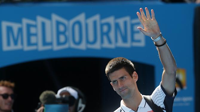 Serbia's Novak Djokovic waves as he leaves Rod Laver Arena after defeating Radek Stepanek of the Czech Republic in their third round match at the Australian Open tennis championship in Melbourne, Australia, Friday, Jan. 18, 2013. (AP Photo/Dita Alangkara)