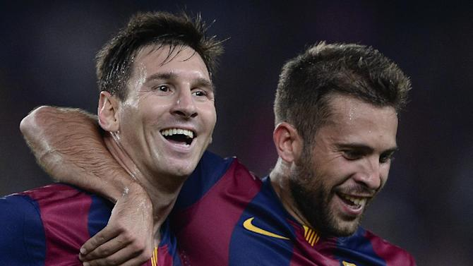 Barcelona's Argentinian forward Lionel Messi (L) is congratulated by teammate defender Jordi Alba after scoring during the Spanish league football match FC Barcelona vs Elche CF at the Camp Nou stadium in Barcelona on August 24, 2014