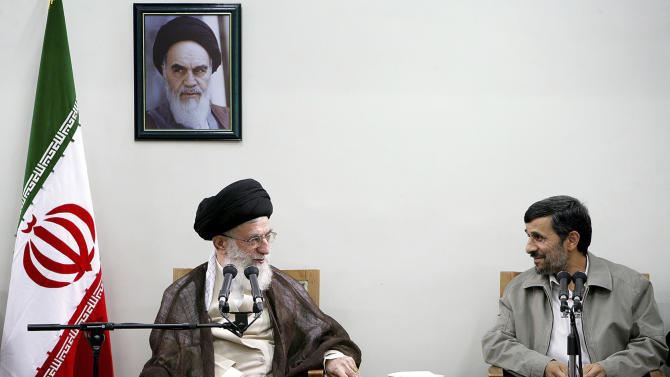 """FILE - In this Sunday, Aug. 29, 2010 file photo released by an official website of the Iranian supreme leader's office, Iranian supreme leader Ayatollah Ali Khamenei, left, and President Mahmoud Ahmadinejad, talk, during a meeting of cabinet and supreme leader, in Tehran, Iran. A portrait of the late revolutionary founder Ayatollah Khomeini hangs on the wall. In the ongoing political skirmishes among Iran's leadership, it was the equivalent of bringing out the heavy ammunition: The country's most powerful figure warning that the post of elected president could someday be scrapped. Although no overhauls appear on immediate horizon after Supreme Leader Ayatollah Ali Khamenei's comment _ he spoke only vaguely about possibilities in the """"distant future"""" _ the mere mention of eliminating Iran's highest elected office shows the severity and scope of the power struggle between Khamenei and President Mahmoud Ahmadinejad. (AP Photo/Office of the Supreme Leader, File) ** EDITORIAL USE ONLY, NO SALES **"""