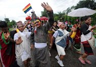 Participants pose for photos during Nepal's international gay pride parade in Chitwan, some 160 km south of Kathmandu, in 2011