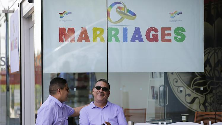 Jose Guerrero, left, and Patrick Rodriguez chat before their wedding ceremony in West Hollywood, Calif., Monday, July 1, 2013. The city of West Hollywood is offering civil marriage ceremonies for same-sex couples free of charge Monday. (AP Photo/Jae C. Hong)