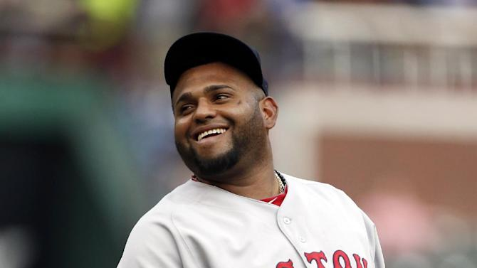 Boston Red Sox third baseman Pablo Sandoval smiles as he warms up on the field before a baseball game against the Texas Rangers, Thursday, May 28, 2015, in Arlington, Texas. (AP Photo/Brandon Wade)