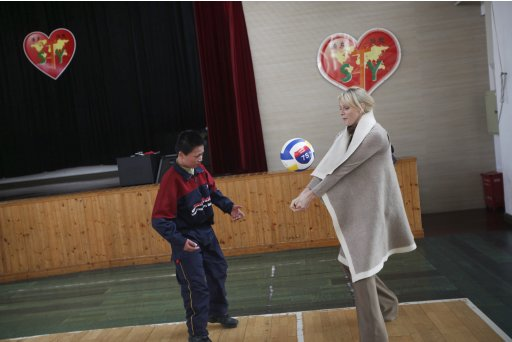 Princess Charlene Wittstock of Monaco plays volleyball with a student of the Shanghai Pudong Special Education School during a visit in Shanghai