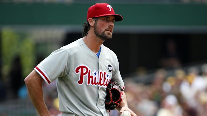 FILE - In this June 14, 2015, file photo, Philadelphia Phillies starting pitcher Cole Hamels collects himself on the mound during the fourth inning of a baseball game against the Pittsburgh Pirates in Pittsburgh. Two people familiar with the deal say the Phillies have agreed to trade Hamels to the Texas Rangers for a package of prospects. Both people spoke to The Associated Press late Wednesday night, July 29, 2015, on condition of anonymity because the trade has not been finalized. Hamels has a limited no-trade clause but does not have to approve a deal to the Rangers. (AP Photo/Gene J. Puskar, File)