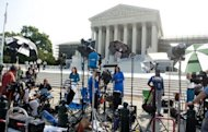 "Reporters await a decision by the US Supreme Court on the constitutionality of the Affordable Healthcare Act, US President Barack Obama's signature healthcare legislation, outside the Supreme Court in Washington, DC, June 28. Obama claimed a ""victory"" for all Americans after the Supreme Court upheld his reforms to extend health insurance to another 32 million citizens"