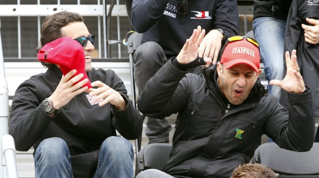 Tony Kanaan talks with Dario Franchitti during the drivers meeting for the Indianapolis 500 at the Indianapolis Motor Speedway in Indianapolis