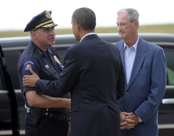 President Barack Obama greets Aurora (Colo.) Police Chief Daniel Oates, as Mayor Steve Hogan, right, watches after Obama arrived at at Buckley Air Force Base, Colo., Sunday, July 22, 2012. Obama is traveling to Aurora to visit with families of victims of the movie theater shooting as well as local officials. (AP Photo/Susan Walsh)