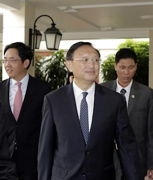 Chinese State Councilor Yang Jiechi, center, arrives at a hotel in Hanoi, Vietnam Tuesday, June 17, 2014. Yang's visit is the first high-level meeting between the two countries since China's deployment of a giant oil rig off the Vietnamese coast last month increased tensions between the neighbors. (AP Photo/Tran Van Minh)