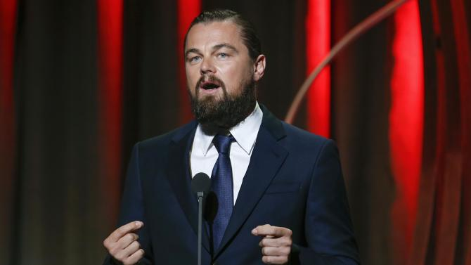 Actor Leonardo DiCaprio speaks after accepting his Clinton Global Citizens award for philanthropy during the Clinton Global Initiative 2014 in New York