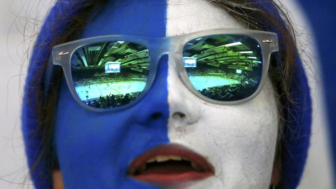 The CEZ arena is reflected on the sunglasses of a Finland's supporter during their Ice Hockey World Championship game against Denmark in Ostrava