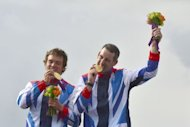"Gold medalists Britain's Tim Baillie (L) and Etienne Stott pose on the podium after the Canoe Double Men's Slalom Final at the ""Lee Valley White Water Centre"", on day 6 of the London 2012 Olympic Games"