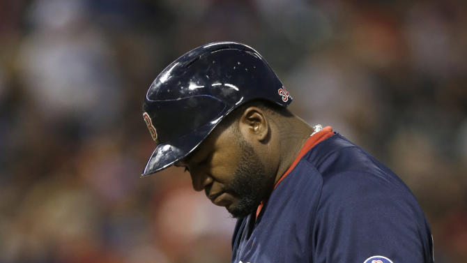 CORRECTS THAT ORTIZ IS REACTING TO STRIKE, NOT A STRIKEOUT - ADDS RESULT OF AT-BAT - Boston Red Sox designated hitter David Ortiz reacts to a strike during the fourth inning of a baseball game against the Texas Rangers on Friday, May 3, 2013, in Arlington, Texas. Ortiz hit into a double play on the at-bat. (AP Photo/LM Otero)