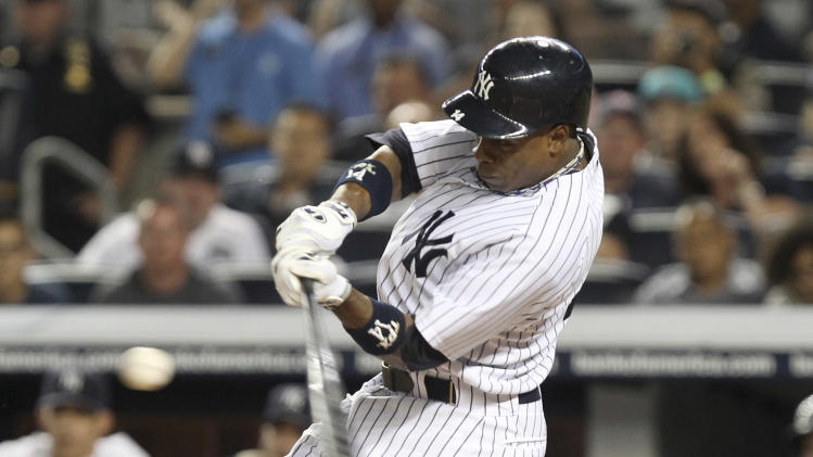 New York Yankees' Curtis Granderson hits an RBI double during the first inning of the baseball game against the Boston Red Sox Sunday, Aug. 19, 2012 at Yankee Stadium in New York.  (AP Photo/Seth Wenig)