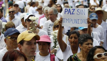 People take part in a demonstration demanding peace without impunity, and against the FARC rebels in Cali