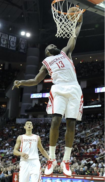 Houston Rockets' James Harden (13) dunks the ball as Jeremy Lin (7) looks on in the second half of an NBA basketball game Saturday, Feb. 1, 2014, in Houston. The Rockets won 106-92