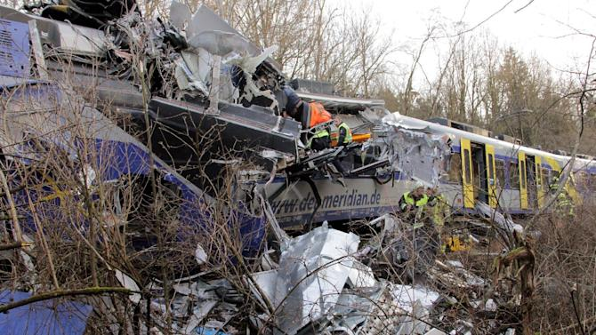 Rescue forces work at the site of a train accident near Bad Aibling, Germany, Tuesday, Feb. 9,  2016.  Several people where killed after two trains collided head-on. (Josef Reissner/dpa via AP)