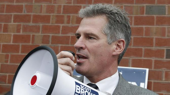 FILE - In this Oct. 24, 2012, file photo, then-Sen. Scott Brown, R-Mass., uses a bull horn at a campaign stop in Watertown, Mass. Three years ago, Brown was a little-known Republican state senator from Massachusetts who shocked Democrats by winning a U.S. Senate seat. Now, having compiled a voting record more moderate than his tea party allies would have liked and losing his bid for a full term, Brown is considering whether to seize a second chance to return to the Senate in another special election. (AP Photo/Charles Krupa, File)