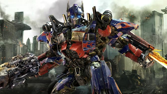 "In this publicity image released by Paramount Pictures, Optimus Prime is shown in a scene from ""Transformers: Dark of the Moon."" The backers of the fourth installment in the blockbuster franchise announced Thursday that four people will win roles through the ""'Transformers 4' Chinese Actors Talent Search Reality Show."" (AP Photo/Paramount Pictures)"