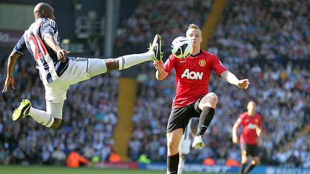 West Bromwich Albion's Youssouf Mulumbu and Manchester United's Alexander Buttner (right) battle for the ball (PA)