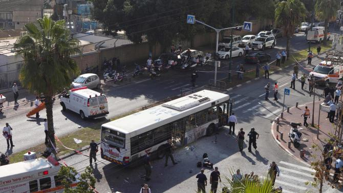 A destroyed bus is seen at the site of a bombing in Tel Aviv, Israel, Wednesday, Nov. 21, 2012. A bomb ripped through an Israeli bus near the nation's military headquarters in Tel Aviv on Wednesday, wounding at several people, Israeli officials said. The blast came amid a weeklong Israeli offensive against Palestinian militants in Gaza that has killed more than 130 Palestinians.(AP Photo/Dan Balilty)