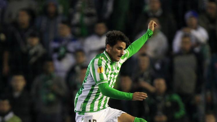 Real Betis' Juan Carlos Perez jumps over Rijeka's Josip Brezovec during their Europa League soccer match in Seville