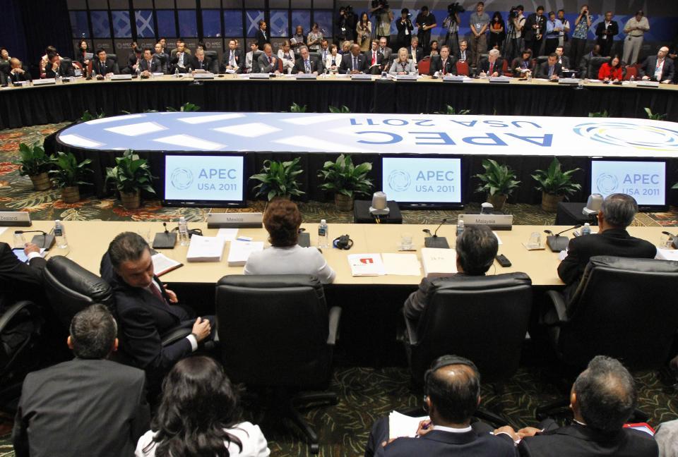 U.S. Secretary of State Hillary Clinton, center top, leads an APEC joint ministerial meeting at the Asia-Pacific Economic Cooperation summit Friday, Nov. 11, 2011, in Honolulu. From left in front row are  (AP Photo/J. David Ake)