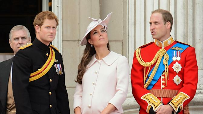 """Britain's Prince Harry, left, Kate, Duchess of Cambridge, center, and Prince William, on the balcony of Buckingham Palace, during the Trooping The Colour parade, in London, Saturday, June 15, 2013. Queen Elizabeth II celebrated her birthday with traditional pomp and circumstance _ but without her husband by her side.  Prince Philip remains in the hospital, recovering from exploratory abdominal surgery. The queen invited her cousin, the Duke of Kent, to accompany her in a vintage carriage. Other royals — including Prince Harry and the Duchess of Cambridge — joined in the celebration Saturday. More than 1,000 soldiers, horses and musicians are taking part in the parade known as """"Trooping the Color,"""" an annual ceremony. (AP Photo/Dominic Lipinski/PA) UNITED KINGDOM OUT"""