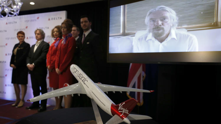 Founder and Chariman of Virgin Group Richard Branson speaks via teleconference during a news conference in New York, Tuesday, Dec. 11, 2012. Delta Air Lines said it will buy almost half of Virgin Atlantic for $360 million as it tries to catch up to rivals in the lucrative New York-to-London travel market. (AP Photo/Seth Wenig)