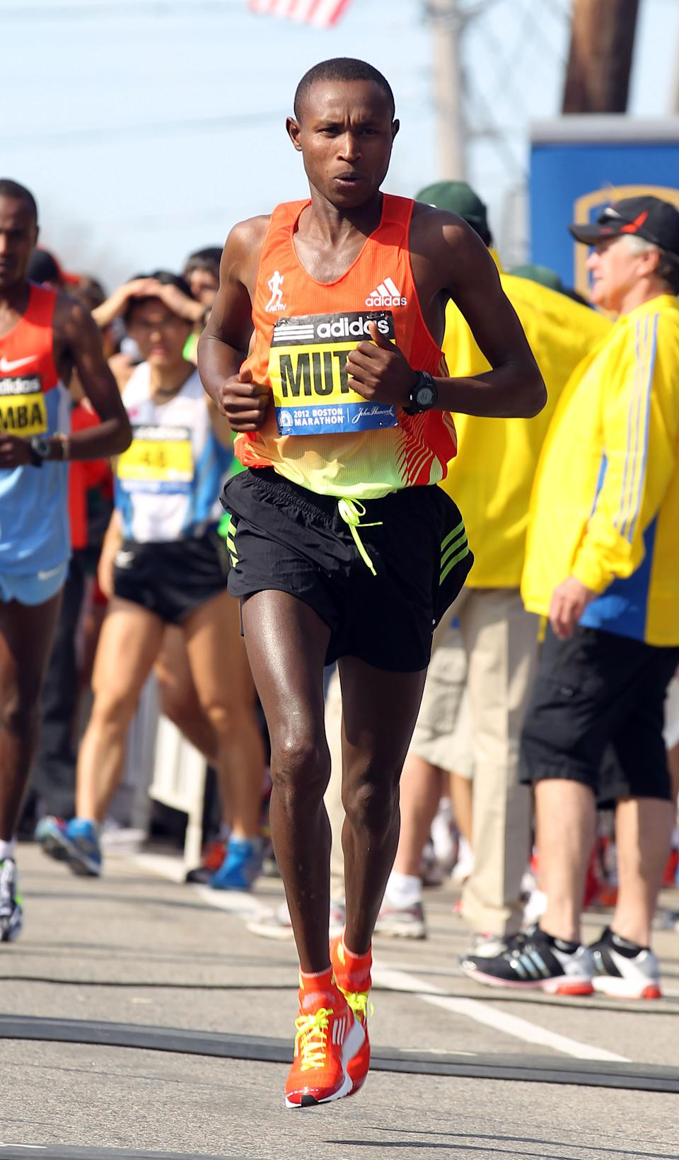 Geoffrey Mutai, of Kenya, warms up prior to the start of the 116th running of the Boston Marathon, in Hopkinton, Mass., Monday, April 16, 2012. (AP Photo/Stew Milne)