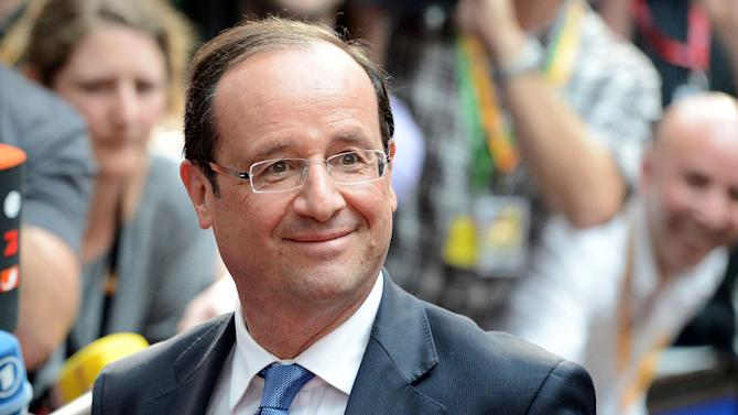 French President Francois Hollande arrives for an EU summit at the EU Council in Brussels, Wednesday, May 23, 2012. The leaders of the 27 countries that make up the European Union are to meet in Brussels Wednesday to try and find a way to keep the debt crisis in Europe from spiraling out of control and promote jobs and growth. (AP Photo/Geert Vanden Wijngaert)