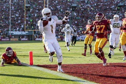 Barner, No. 2 Oregon beat No. 18 USC 62-51