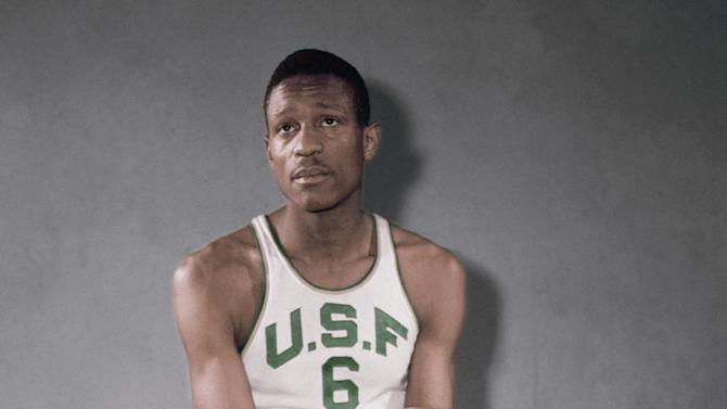 FILE - In this Feb. 23, 1956 file photo, University of San Francisco basketball player Bill Russell poses for a photo.A four-year-old federal lawsuit aims to cut players in on the action and dramatically alter the financial relationship between student-athletes and the NCAA. Former athletes such as UCLA basketball star and the NCAA tournament's most outstanding player in 2005, Ed O'Bannon, and others like Oscar Robertson and Russell argue they are entitled to share in the spoils earned from their labors.  (AP Photo/File)