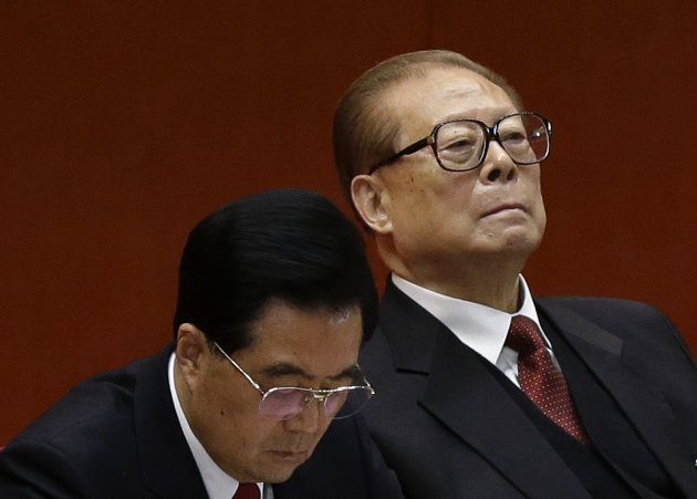 Former Chinese President Jiang Zemin, right, and Chinese President Hu Jintao attend the closing ceremony of the 18th Communist Party Congressheld at the Great Hall of the People in Beijing Wednesday,