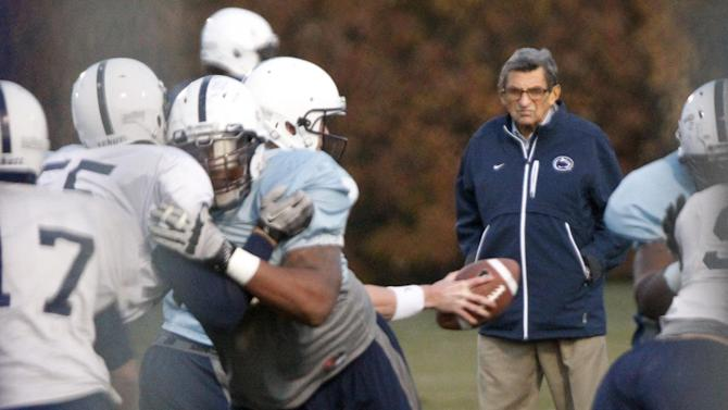 Penn State coach Joe Paterno watches his football team practice, Wednesday, Nov. 9, 2011, in State College, Pa. Paterno, who preached success with honor for half a century but whose legend was shattered by a child sex abuse scandal, said Wednesday that he will retire at the end of this season. (AP Photo/Matt Rourke)
