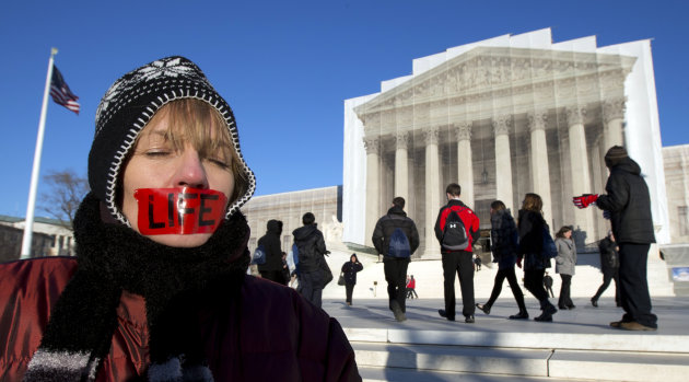 Anti-abortion activist, Jenese English, voices her opinion in front of the U.S. Supreme Court in Washington, Tuesday, Jan. 22, 2013 coinciding with the 40th anniversary of Roe v. Wade, the Supreme Cou