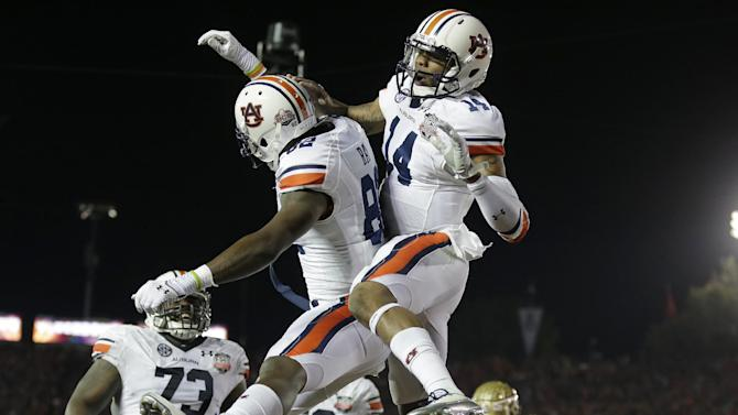 Auburn's Nick Marshall (14) congratulates Melvin Ray (82) after Ray's touchdown catch during the first half of the NCAA BCS National Championship college football game against Florida State Monday, Jan. 6, 2014, in Pasadena, Calif. (AP Photo/Chris Carlson)