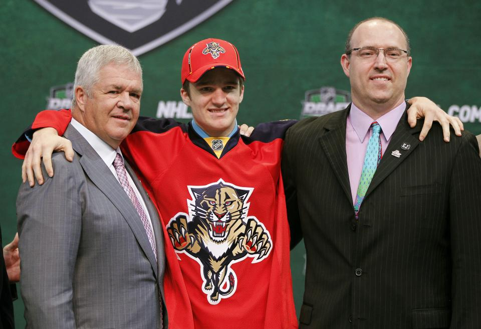 Jonathan Huberdeau, center, poses with Florida Panthers officials after he was drafted by the team in the first round of the National Hockey League entry draft, Friday June, 24, 2011, in St. Paul, Minn. (AP Photo/Andy King)