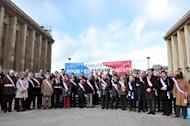 Some 50 mayors and deputy mayors demonstrate against a draft law to authorise gay marriage and adoption on December 15, 2012 in Paris. Passions and tensions are rising in France ahead of an expected giant weekend rally against the government&#39;s plan to legalise same-sex marriage and adoption that has angered influential Catholic and Muslim groups