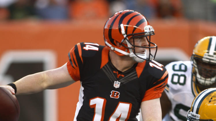 Cincinnati Bengals quarterback Andy Dalton (14) escapes the rush in the first half of an NFL preseason football game against the Green Bay Packers, Thursday, Aug. 23, 2012, in Cincinnati. (AP Photo/John Grieshop)