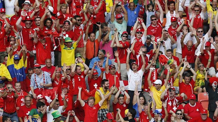 Switzerland fans cheer during the group E World Cup soccer match between Honduras and Switzerland at the Arena da Amazonia in Manaus, Brazil, Wednesday, June 25, 2014. (AP Photo/Frank Augstein)