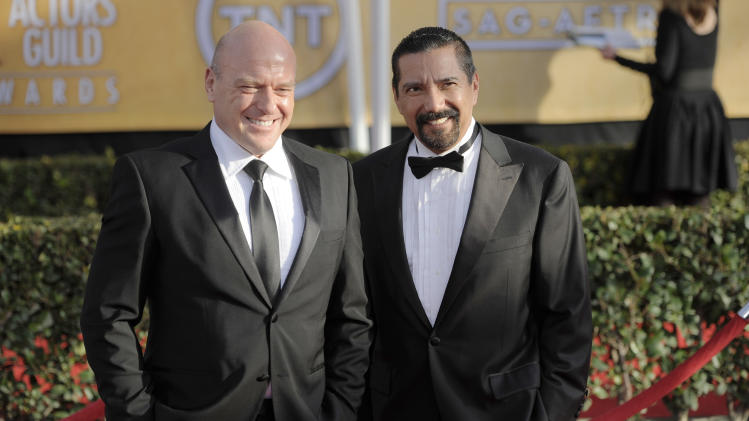 "FILE - This Jan. 27, 2013 file photo shows actors Dean Norris, left, and Steven Michael Quezada at the 19th Annual Screen Actors Guild Awards  in Los Angeles. Quezada, who plays federal drug agent Steven Gomez on the Albuquerque-based show ""Breaking Bad,"" is running unopposed Tuesday, Feb. 5, 2013, for a seat on Albuquerque's school board.  Norris stars with Quezada on the popular AMC show. (Photo by Chris Pizzello/Invision/AP, file)"