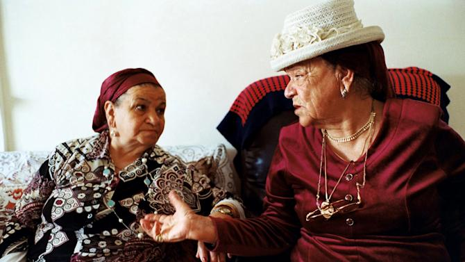 """In this photo provided by Les Films d'un Jour, a still from the documentary """"Tinghir-Jerusalem: Echoes from the Mellah,"""" shows Aicha Elkoubi, left, and Hannah Schmouyane, Moroccan Jews who immigrated to Israel, reminisce about the old days in Yavne, south of Tel Aviv. Once home to some 300,000 Jews, the largest population in the Arab world, Morocco is increasingly taking a fresh look at its long history with Judaism and is spurning the flat rejection of all things Hebrew found in so many other Arab countries. (AP Photo/Les Films d'un Jour)"""