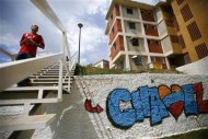 A man walks down an stairway in Ciudad Caribia outside Caracas September 19, 2013. REUTERS/Jorge Silva