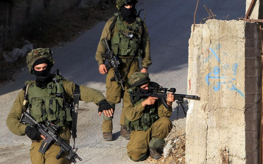 10 Palestinians wounded as Israel hunts settlers' killers