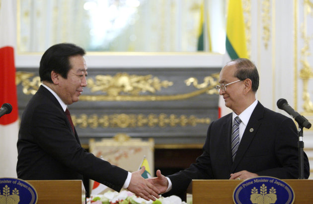 Japanese Prime Minister Yoshihiko Noda, left, and Myanmar's President Thein Sein shake hands after a joint press conference following their meeting held on the sidelines of the Mekong-Japan Summit at the State Guest House in Tokyo on Saturday, April 21, 2012. (AP Photo/Tomohiro Ohsumi, Pool)