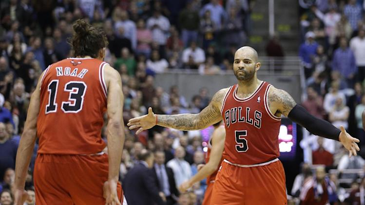 Chicago Bulls' Joakim Noah (13) and teammate Carlos Boozer (5) celebrate in the fourth quarter of an NBA basketball game against the Utah Jazz Friday, Feb. 8, 2013, in Salt Lake City. The Bulls defeated the Jazz 93-89. (AP Photo/Rick Bowmer)